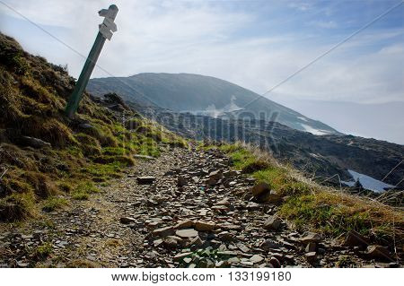 Pointers distances at mountain top. Mountains in the Carpathians.