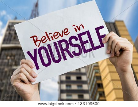 Believe in Yourself placard with urban background
