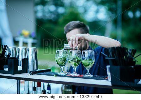 Bartender Making A 3 Mojito Cocktails