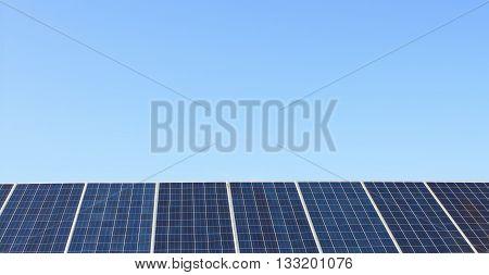big Solar panels over deep blue sky