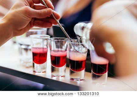 Bartender Pouring Shots Cocktails