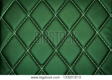 Genuine leather upholstery background for a luxury decoration in green tones