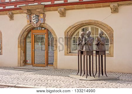 Backnang, Germany - April 3 2016: Historical townhall entrance with sculpture on the right