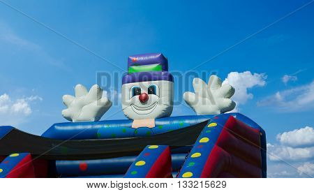 Children's bouncy castle detail against a summer's clear deep blue sky