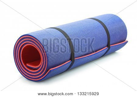 Rolled blue foam yoga mat isolated on white