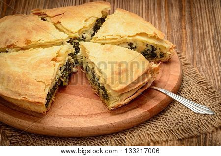 Delicious pie with spinach and feta cheese - spanakopita, traditional greek cuisine.