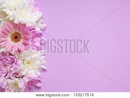 A floral arrangement of pink and white flowers on a pink background, forming a page border