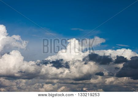 Cumulus clouds on a background of deep blue sky