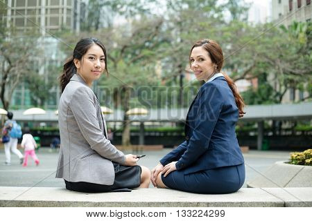 Business woman sitting down at outdoor