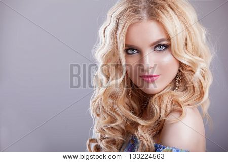 beautiful girl model woman portrait professional makiyad and hair in a flower dress on a floral background bright tone pink lips blonde hair blonde curls sound around very cute and beautiful.