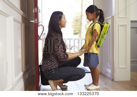 Mother And Daughter Leaving Home For School