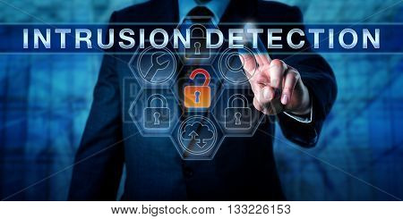 Businessman is pushing INTRUSION DETECTION on an interactive control screen. Cyber security concept and information technology metaphor for software tools scanning for the latest malware threats.