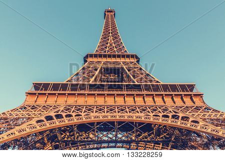 The Eiffel Tower located on the Champ de Mars in Paris France selective focus vintage effect