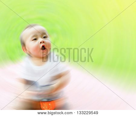Asian boy hold pumpkin doll in hand spin blur sleepy in magic emotion