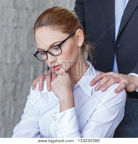 Boss put hands on secretary shoulder in office