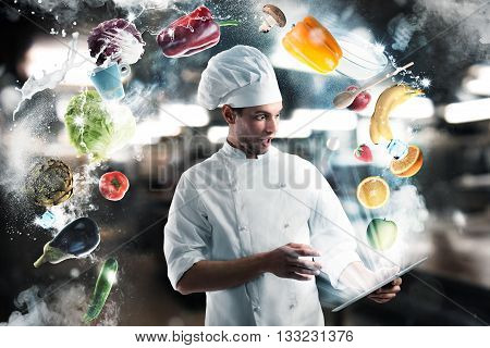 Chef looks stunned the tablet with fruits and vegetables