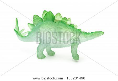 side view green stegosaurus toy on a white background