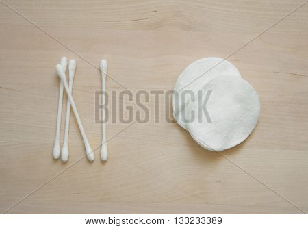 cotton for face cleansing and cotton buds on wood background