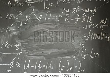 math formulas written in white chalk and copy space on black board