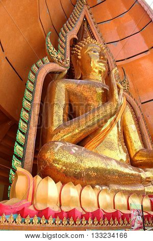 big gold buddha statue from bottom eye view