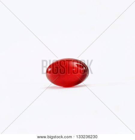 red omega 3 krill capsules on white