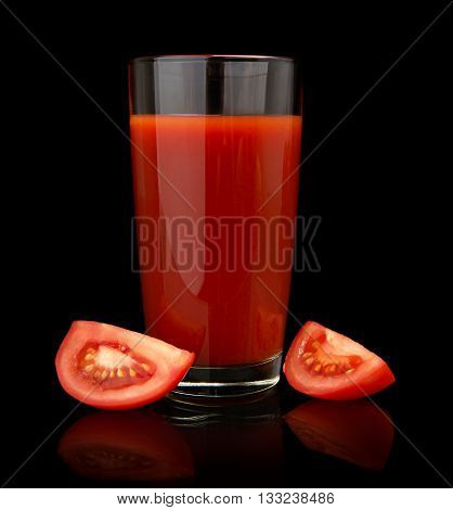 Glass Of Tomato Juice With Quarters Of Tomatoes On Black