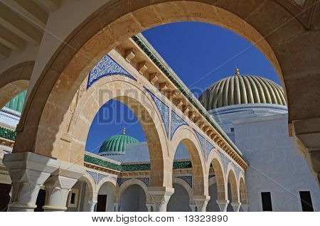 Golden dome, arches and green dome
