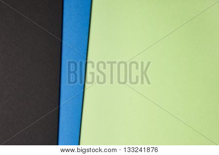 Colored cardboards background in green blue black tone. Copy space. Horizontal
