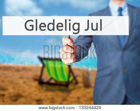 Gledelig Jul (happy Christmas In Norwegian) - Businessman Hand Holding Sign