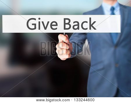 Give Back - Businessman Hand Holding Sign