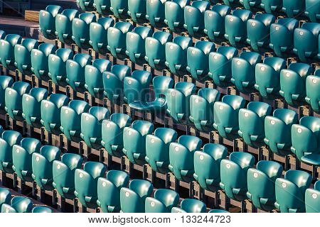 Rows of stadium seats and one special centeral seat