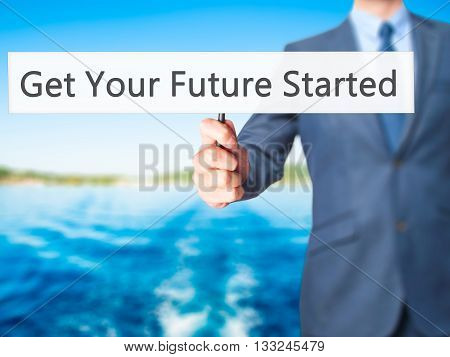 Get Your Future Started - Businessman Hand Holding Sign
