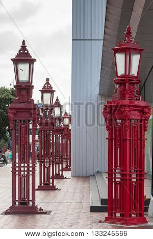 Line of red street lamp posts in Auckland New Zealand