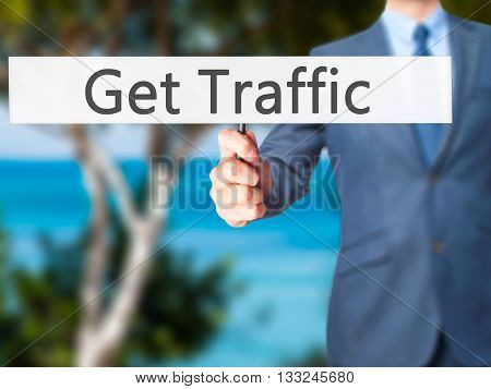 Get Traffic - Businessman Hand Holding Sign
