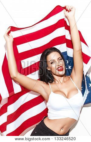 Sexy woman with big tits holding USA flag licking teeth with tounge