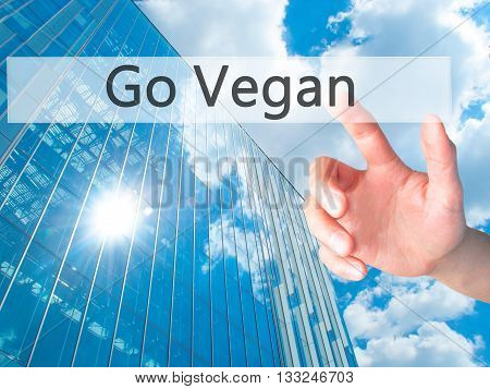 Go Vegan - Hand Pressing A Button On Blurred Background Concept On Visual Screen.