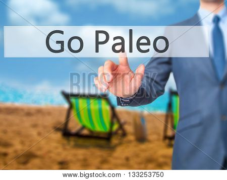 Go Paleo - Businessman Hand Pressing Button On Touch Screen Interface.