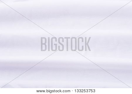 Close up of wrinkled white bedsheet texture background.