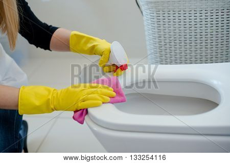 Woman In Yellow Rubber Gloves Cleaning Toilet