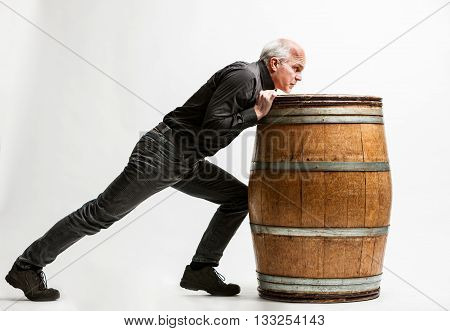 resolute artisan pushing a wine barrel (on a white background)