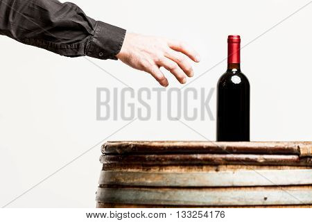Hand Of A Man About To Grasp A Wine Bottle