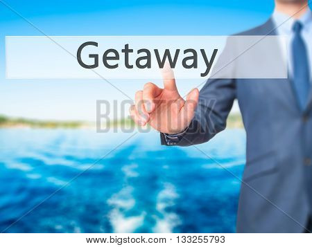Getaway - Businessman Hand Pressing Button On Touch Screen Interface.