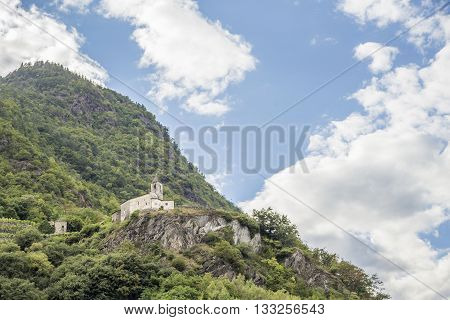 A hermitage perched high on a mountain in Valtellina on the Bergamasque Alps in Italy