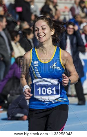 CAGLIARI, ITALY - December 7, 2014: 7 ^ Half Marathon - Memorial Delio Serra - portrait of smiling athlete after the race