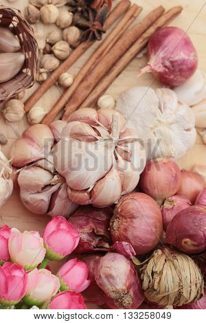 Shallot and garlic for cooking on wood background