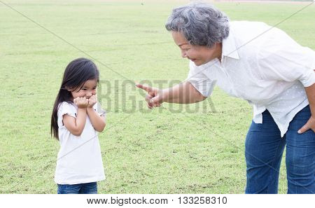 asian grandmother teach the children outdoor park