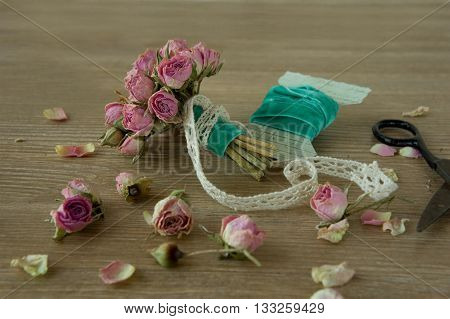 vintage bouquet of dried flowers on a wooden background