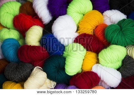 Colorful woolen threads as material for garment products