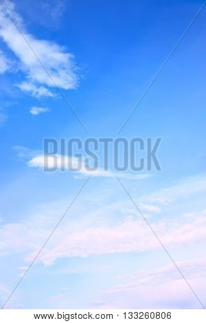 Blue sky with light fleecy clouds - space for your own text