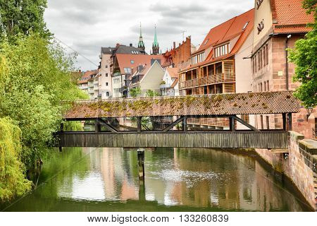 Old covered bridge over Pegnitz river in Nuremberg, Germany